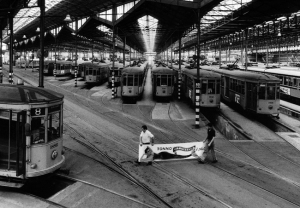 Milan , 1986 - Inside the trolley depot - workers with the advertising placard of